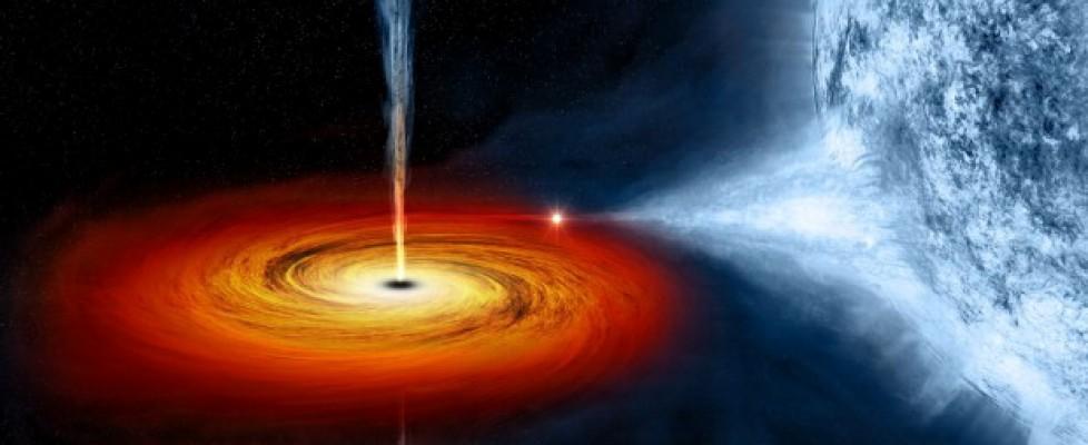 Buco nero che assorbe una stella