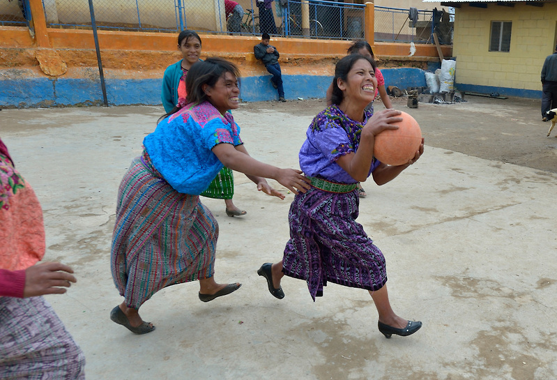 Maria Valentina Lopez drives for the basket as indigenous women play basketball in Tuixcajchis, a small Mam-speaking Maya village in Comitancillo, Guatemala.